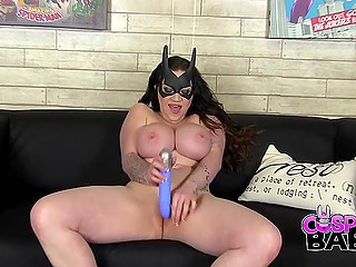 Batman fan presents huge knockers and the video where she masturbates on the couch
