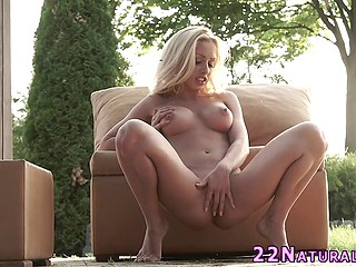 Blonde babe with round boobs Melanie Gold undresses and gently fingers pussy till achieving orgasm