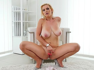 Staggering blonde MILF with a big natural chest needs no cock to receive sexual pleasure