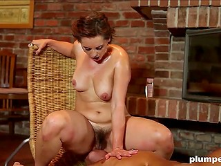 Gorgeous mature dominates bimbo guy in the living room using her hairy pussy and lust for cock