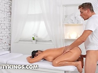 Guy is massaging Latina client with fake boobs when she orders him to take care of her moist pussy