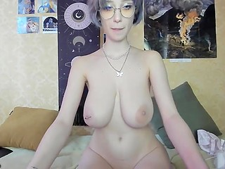 Nerdy webcam girl from Ukraine strokes favorite pink dildo with her massive succulent boobs