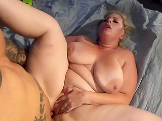 Beautiful BBW blonde gives handsome mulatto nice blowjob followed with intense sex on the bed