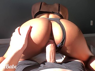 Black-haired babe with round ass rides BF's dick in sunny bedroom before receiving all cum on the chest