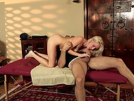 Masseur carefully thrusts penis into the young blonde's vagina after she gives him a blowjob