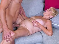 Short-haired blond granny has her hairy peach penetrated with hard cock of well-built lover