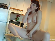 Eccentric redhead discovers dropper in the kitchen and undresses to shove it inside her hairy pussy