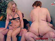Two mature German couples meet in the living room to have so desired swinger sex