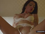 Stunning Italian MILF with black hair and her lover have ardent sex in darkened bedroom