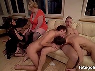Horny guys and voracious chicks take part in bisexual orgy arranged in the big room